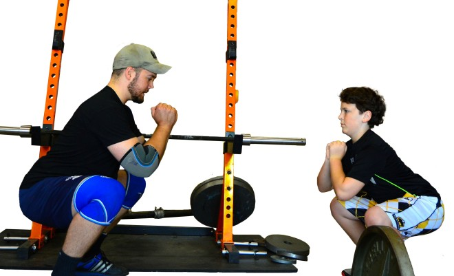 Will working on squats with 12-year old lacrosse player Jonah